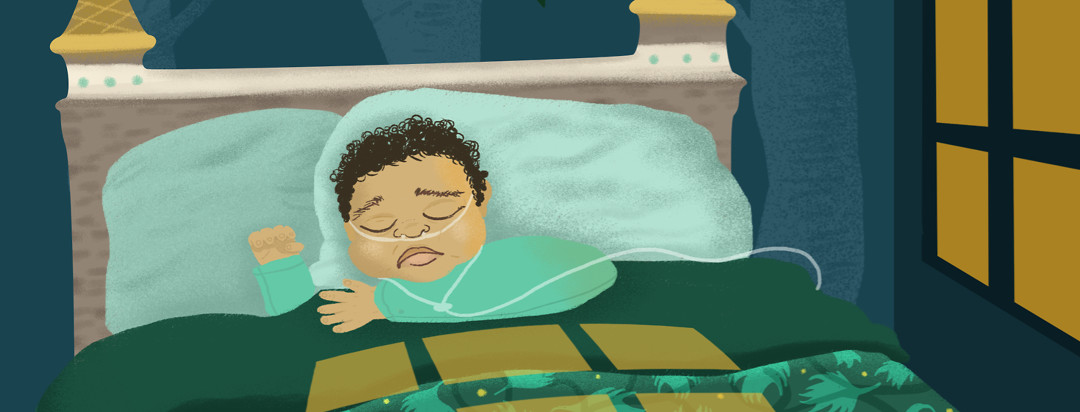 A little boy wearing a nasal cannula furrows his brows in unrest while trying to sleep in his bed with the orange light of the night falling on his blanket from the window.