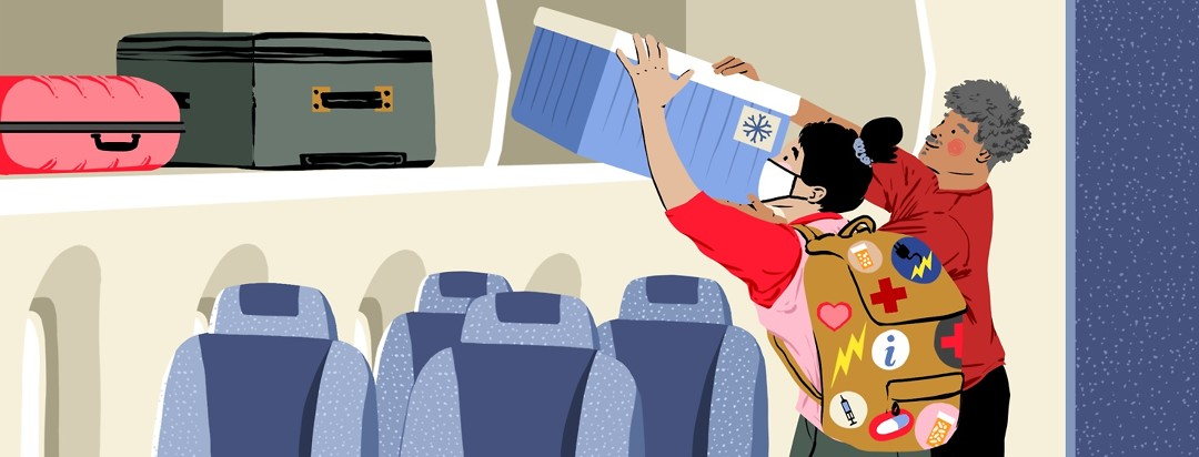 A woman wearing a respiratory mask is helped by a man to load a cooler into the overhead bin in an airplane. The woman's backpack is covered in patches that show things like a bottle of pills, an external battery, and a red cross to indicate what she has in the backpack.