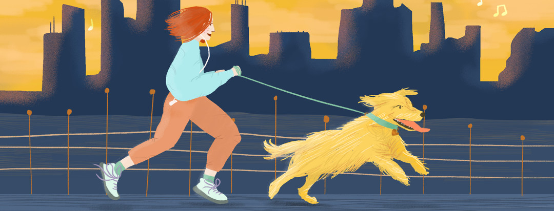 A person goes on a run with their golden retriever during dusk.