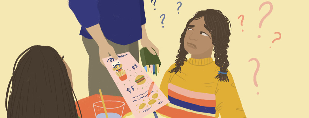 A young looking person gets handed a children's menu at a restaurant, much to her confusion.