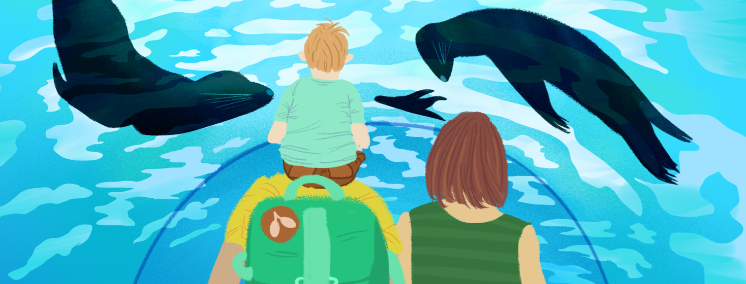 A family of three, with one child sitting on their parent's shoulders, are facing away from the viewer. Sea lions swim around them in a domed aquarium. The parent on the left wears a backpack with a lungs patch adhered.