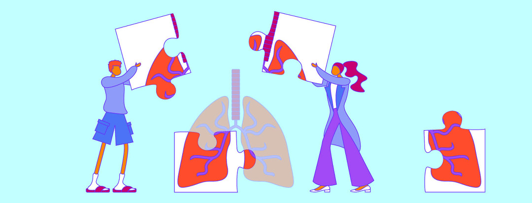 People work together to solve puzzle featuring lungs.
