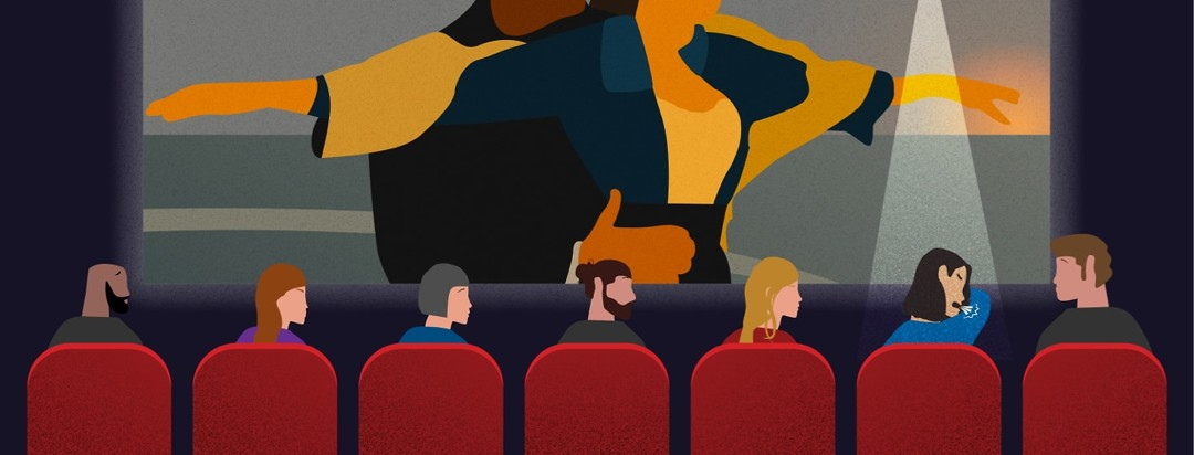 A woman coughing in a crowded movie theater