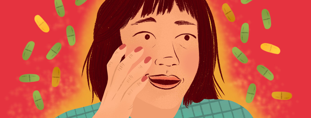Person looks incredulously while touching their face; trikafta pills float around her.