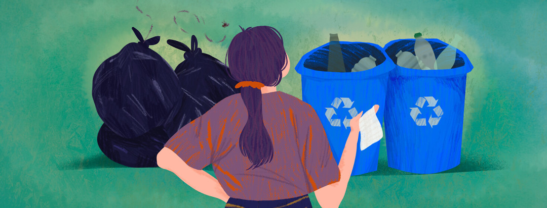 Person holding Tyvek decides between putting it in trash or recycling