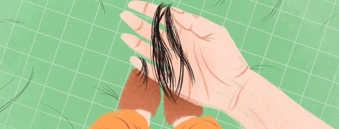 A hand holding a lock of fallen hair, with hair stands strewn across the bathroom floor.