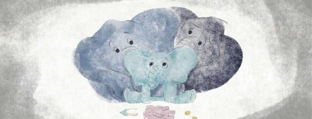 Two elephant parents holding a baby elephant lovingly with a toy elephant and blocks in the foreground