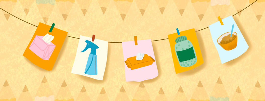 Paper wall banner featuring spray bottle, sanitizer wipes, applesauce, enzymes pill bottle, and a tissue box.