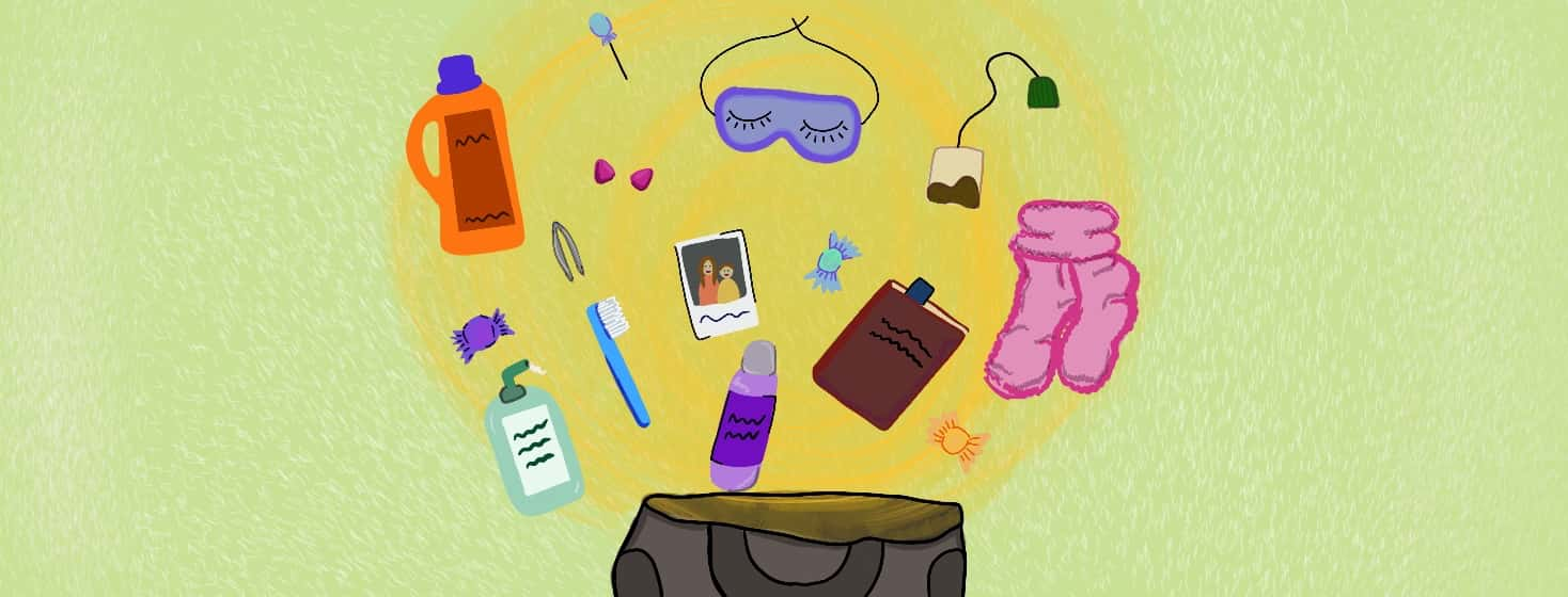 Essential hospital items like fuzzy socks, sleeping mask, toothbrush for an extended hospital stay going into a bag!