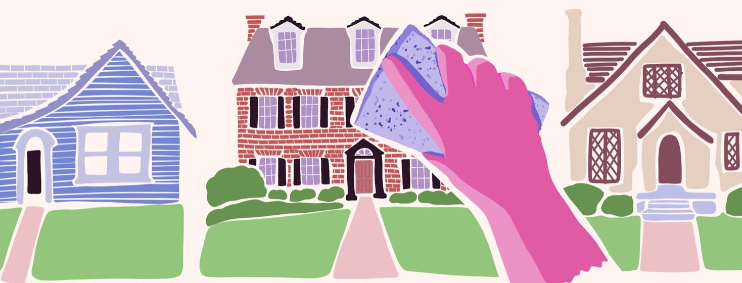 a hand wiping down a house with a sponge