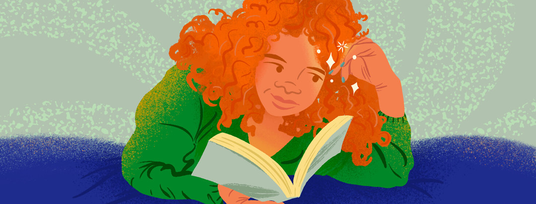 Woman with curly red hair reads book laying down, looking at her sparkling nails