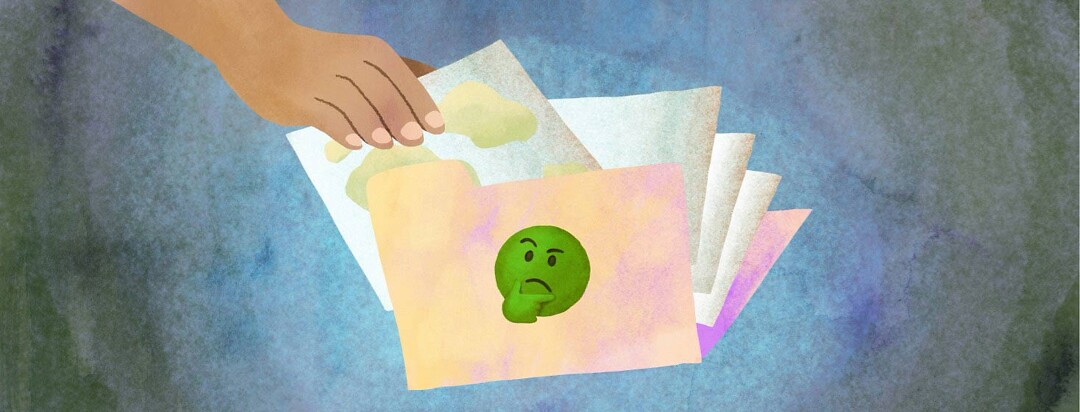 A hand tucking a piece of paper covered in mucus into a file folder with a green thinking face emoji on the front.